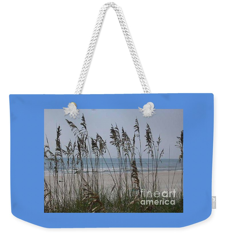 Florida Beach Near St. Augustine Weekender Tote Bag featuring the photograph Thru The Sea Oats by Barb Montanye Meseroll