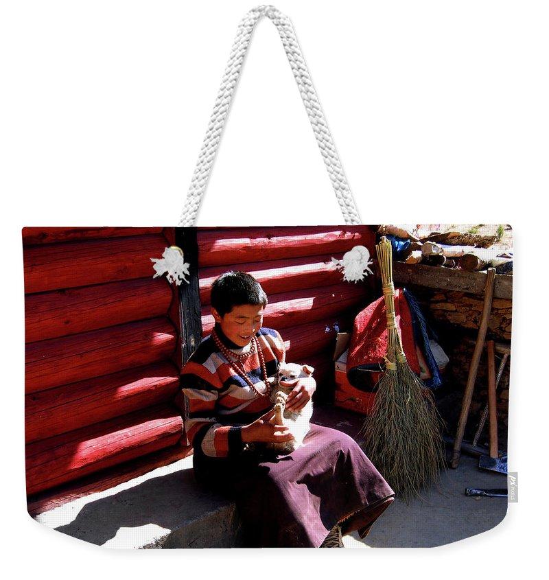 Tibetan Weekender Tote Bag featuring the photograph Tibetan Boy by Tianxin Zheng