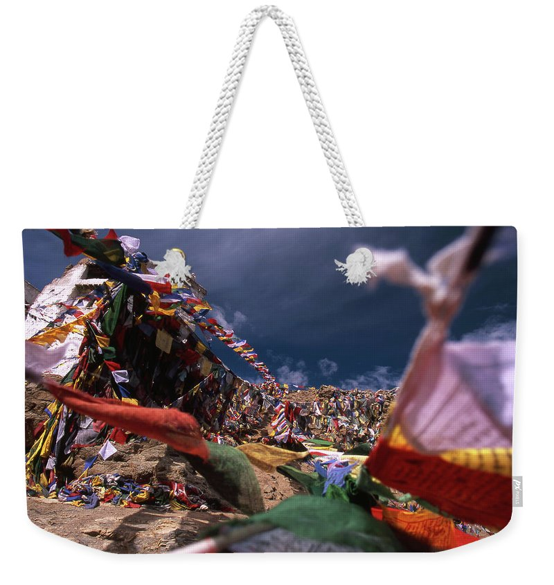 Tibetan Prayer Flags Weekender Tote Bag featuring the photograph Tibetan Prayer Flags - Ladakh I by Patrick Klauss