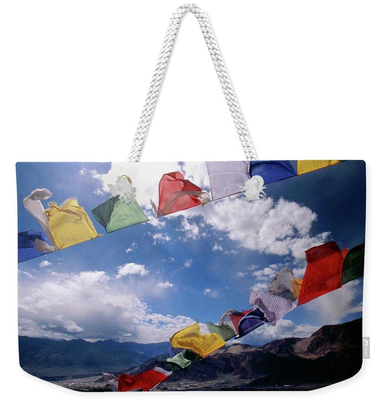 Tibetan Prayer Flags Weekender Tote Bag featuring the photograph Tibetan Prayer Flags - Ladakh II by Patrick Klauss