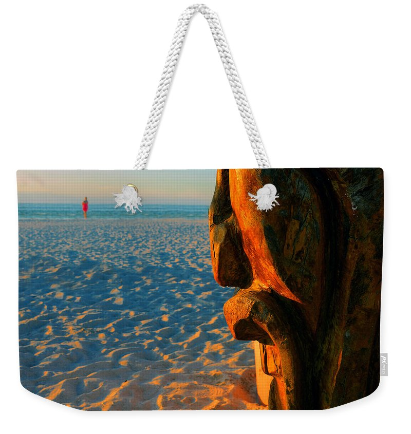 Tiki Weekender Tote Bag featuring the photograph Tiki And The Woman In The Pink Towel by David Lee Thompson