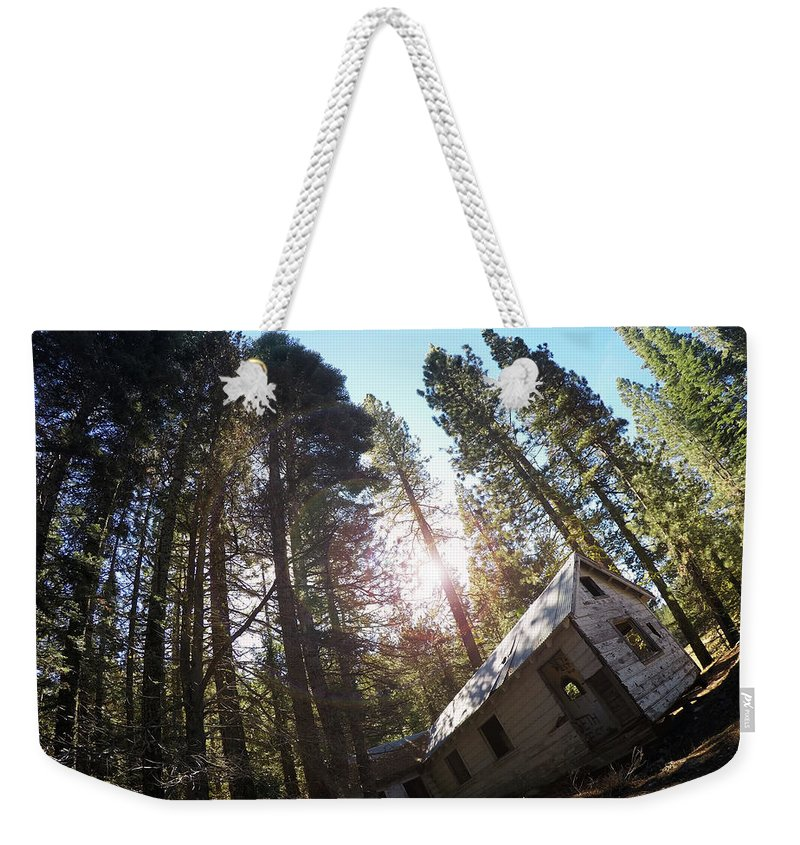 Dilapidated Weekender Tote Bag featuring the photograph Tilted House, Real Estate Series by Aaron James