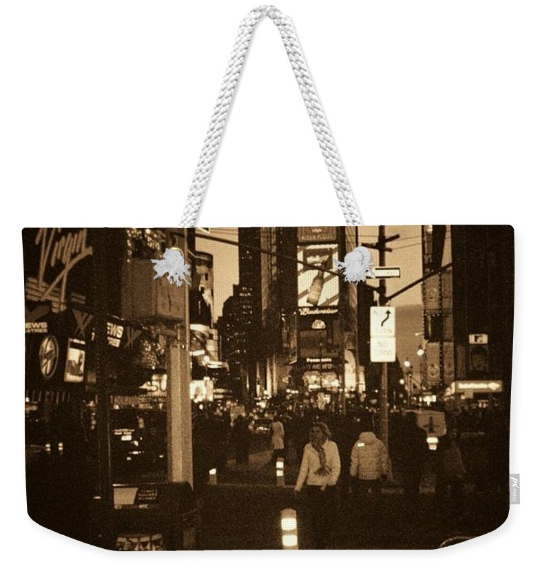 New York Weekender Tote Bag featuring the photograph Times Square by Debbi Granruth