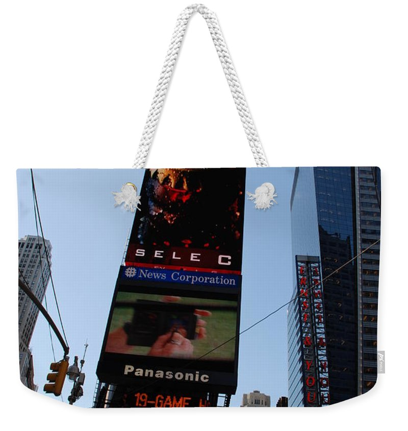 Times Square Weekender Tote Bag featuring the photograph Times Square by Rob Hans