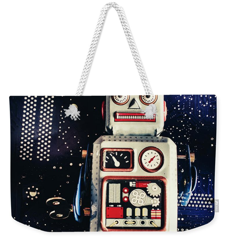 Robot Weekender Tote Bag featuring the photograph Tin Toy Robots by Jorgo Photography - Wall Art Gallery