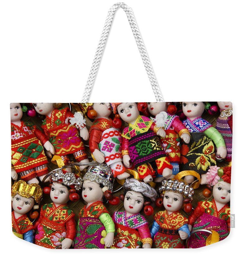 Asia Weekender Tote Bag featuring the photograph Tiny Chinese Dolls by Michele Burgess