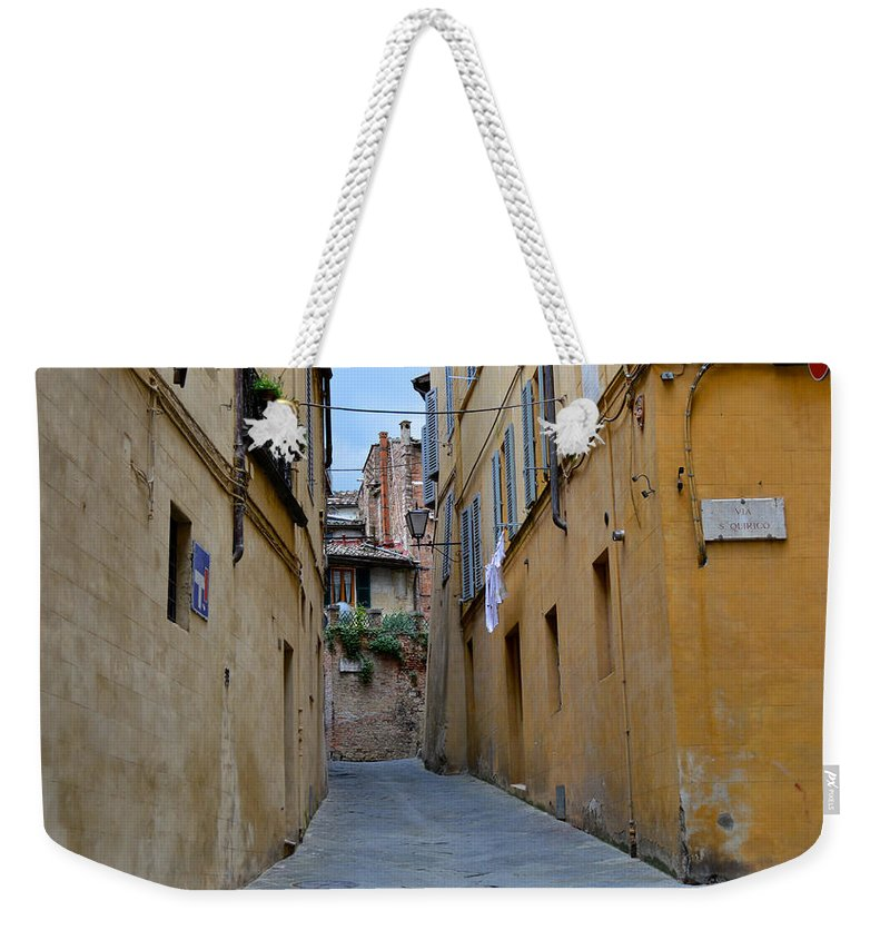 Siena Weekender Tote Bag featuring the photograph Tiny Street In Siena by Chris Alberding