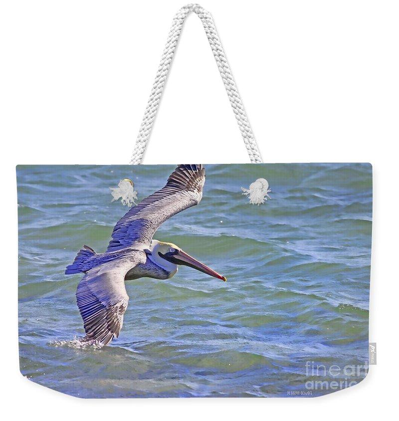 Pelican Weekender Tote Bag featuring the photograph Tip Of The Wing by Deborah Benoit