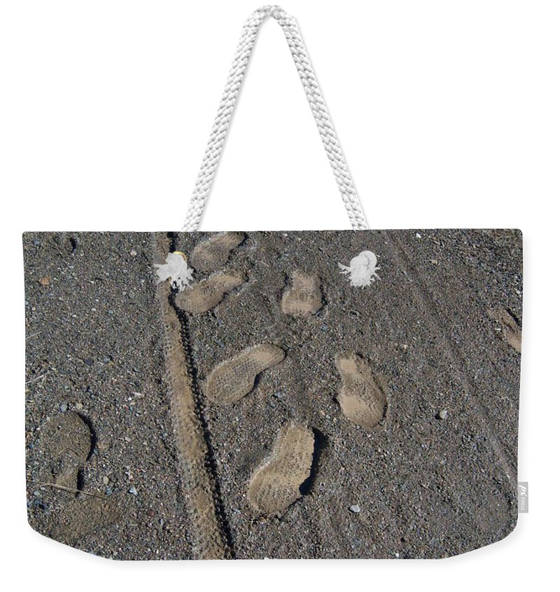 Prescott Weekender Tote Bag featuring the photograph Tire Tracks And Foot Prints by Heather Kirk