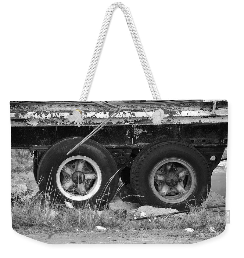 Black And White Weekender Tote Bag featuring the photograph Tires by Rob Hans