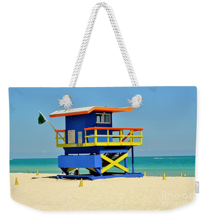 Lifeguard Stand Weekender Tote Bag featuring the photograph To The Rescue 1 by Rene Triay Photography
