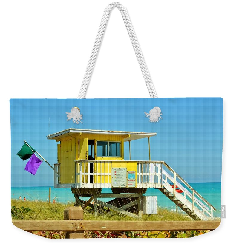 Miami Beach Weekender Tote Bag featuring the photograph To The Rescue 11 by Rene Triay Photography