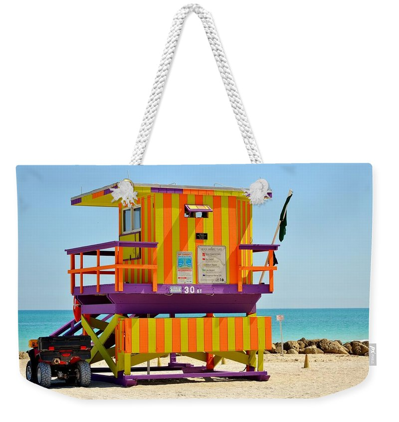 Miami Beach Weekender Tote Bag featuring the photograph To The Rescue 3 by Rene Triay Photography
