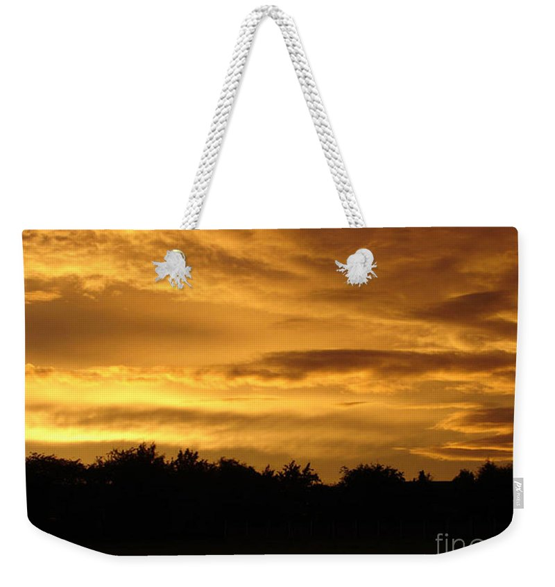 Sunset Weekender Tote Bag featuring the photograph Toffee Sunset by Carol Lynch