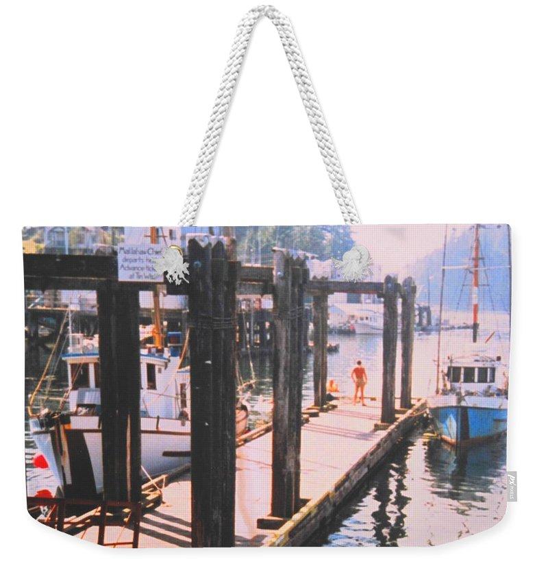 Tofino Weekender Tote Bag featuring the photograph Tofino by Ian MacDonald
