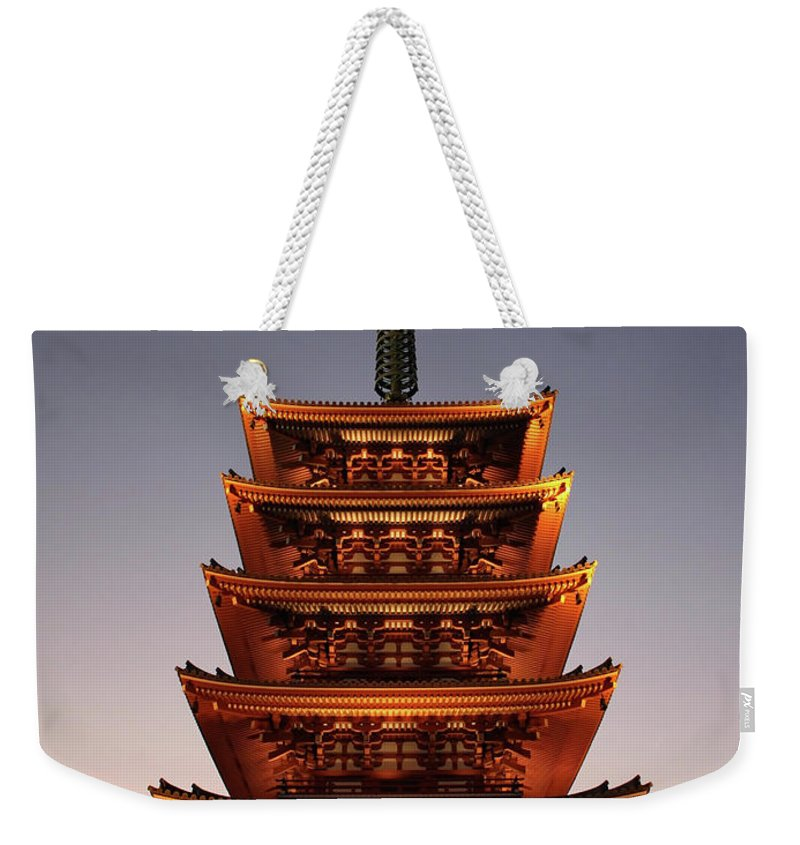 Tokyo Weekender Tote Bag featuring the photograph Tokyo Temple Lights At Dusk by Carol Groenen