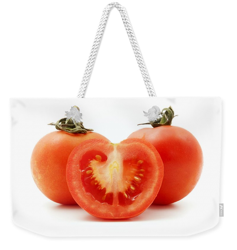White Background Weekender Tote Bag featuring the photograph Tomatoes by Fabrizio Troiani