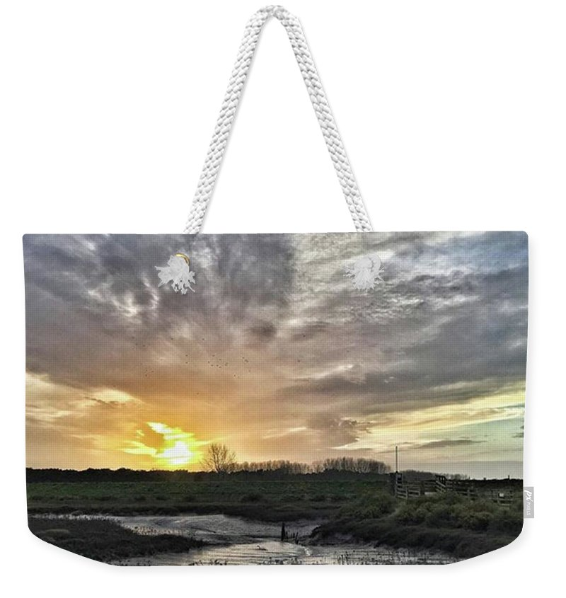 Natureonly Weekender Tote Bag featuring the photograph Tonight's Sunset From Thornham by John Edwards