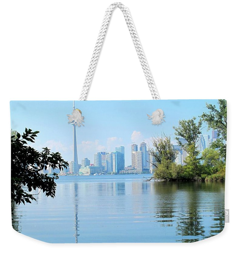 Toronto Weekender Tote Bag featuring the photograph Toronto From The Islands Park by Ian MacDonald