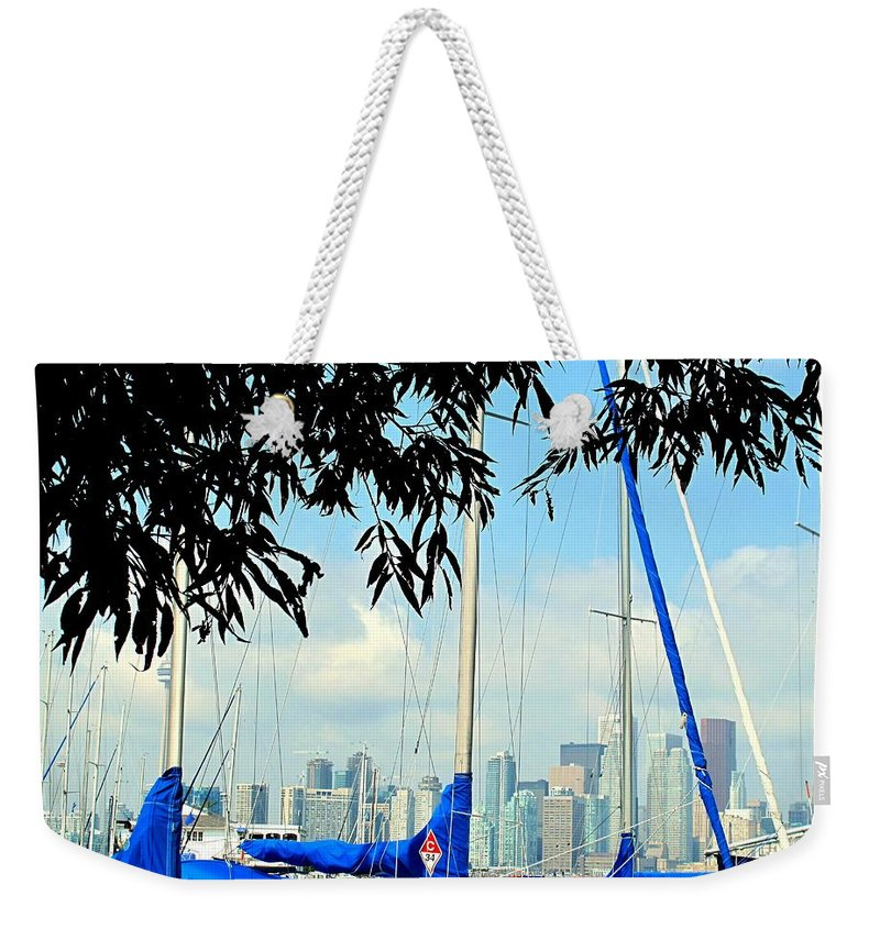 Toronto Weekender Tote Bag featuring the photograph Toronto Through A Forest Of Masts by Ian MacDonald