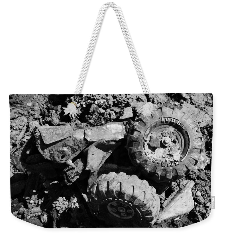 Toy Weekender Tote Bag featuring the photograph Tossed Toy by Angus Hooper Iii