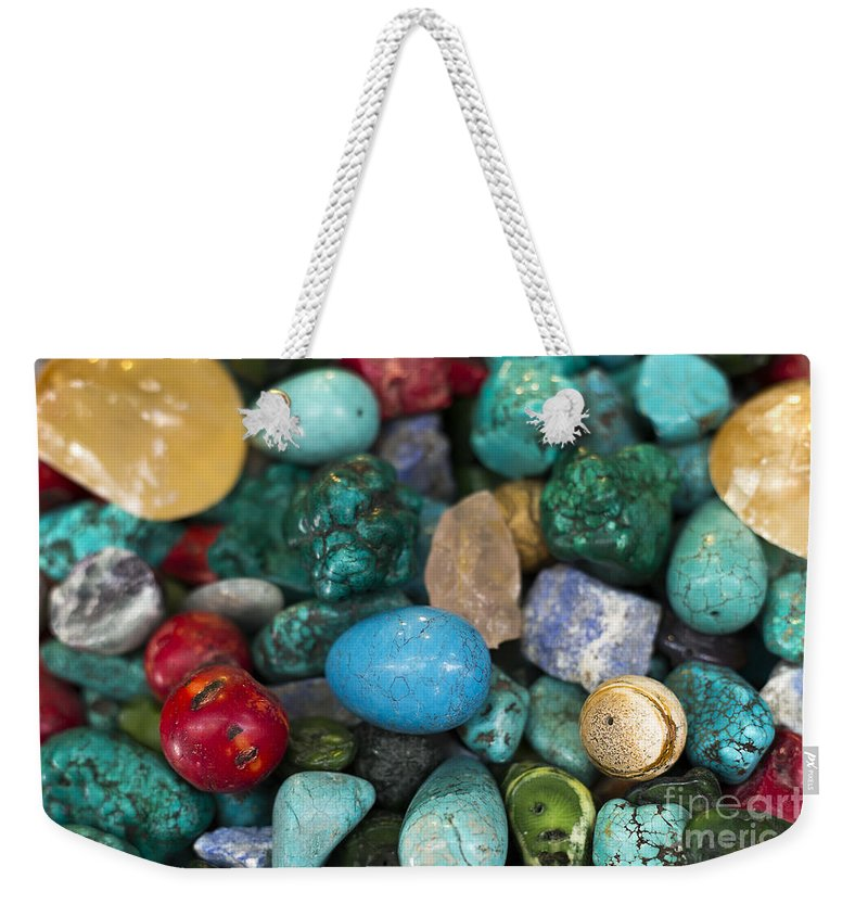 Trinkets Weekender Tote Bag featuring the photograph Tourist Souvenir Stall by Mark Bespalov