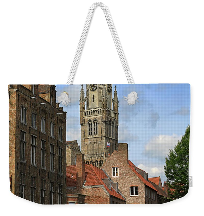Bruges Weekender Tote Bag featuring the photograph Tower Of The Belfrey From The Canal At Rozenhoedkaai by Louise Heusinkveld