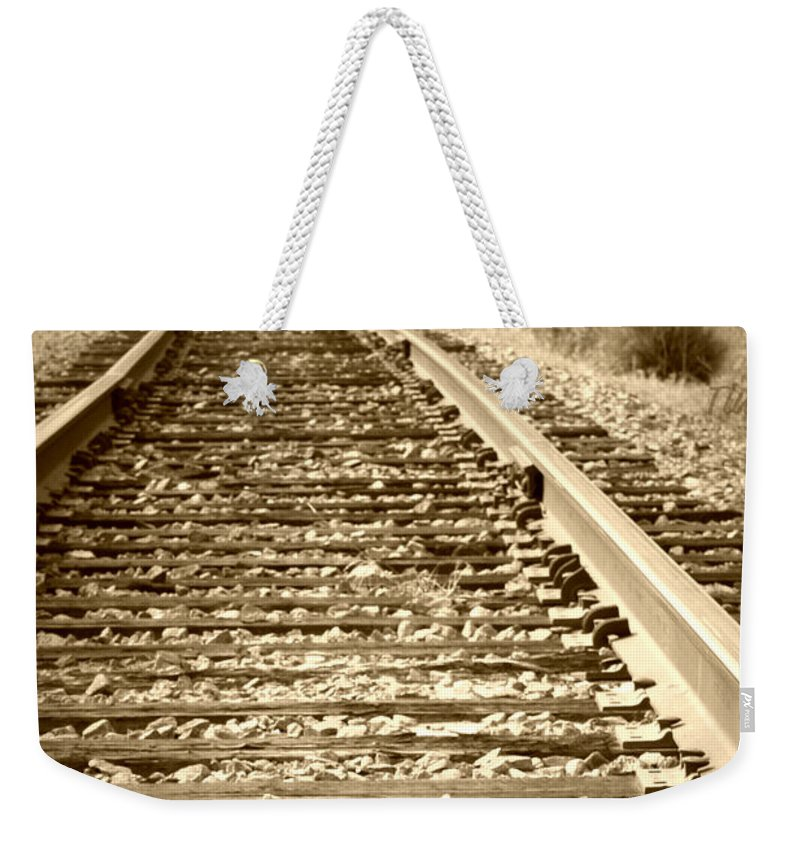Tracks Weekender Tote Bag featuring the photograph Tracks by Tina Meador