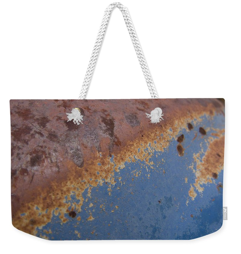 Rust Weekender Tote Bag featuring the photograph Tractor Decomposition by Jeffery Ball