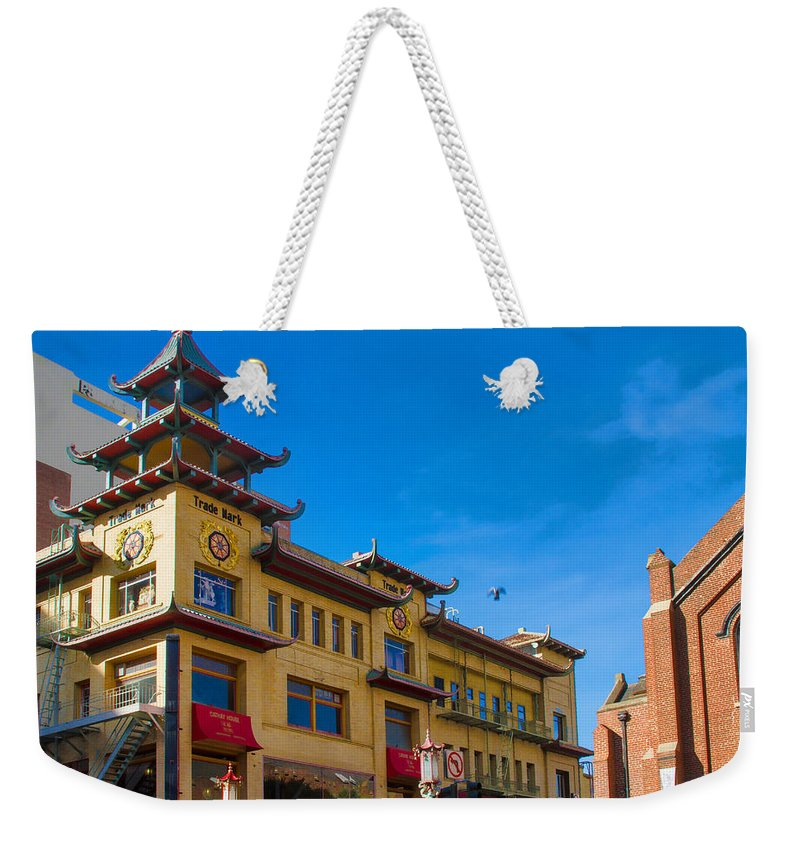 Bonnie Follett Weekender Tote Bag featuring the photograph Trade Mark Building On Grant St by Bonnie Follett