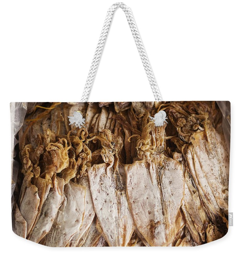 Asia Weekender Tote Bag featuring the photograph Traditional Sun Dried Squid In Kep Market Cambodia by Jacek Malipan