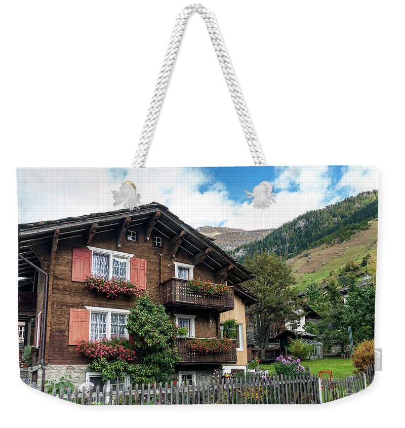 Alpine Weekender Tote Bag featuring the photograph Traditional Swiss Alps Houses In Vals Village Alpine Switzerland by Jacek Malipan