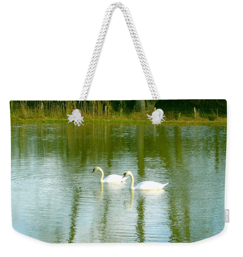 Swans Weekender Tote Bag featuring the photograph Tranquil Reflection Swans by Susan Baker
