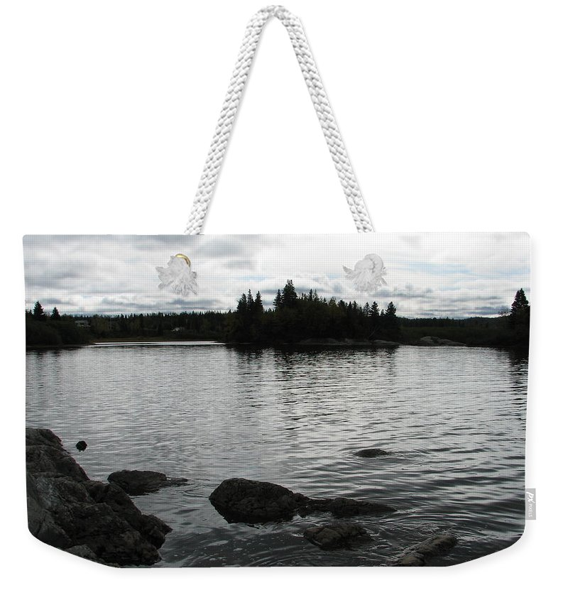 Water Weekender Tote Bag featuring the photograph Tranquility by Kelly Mezzapelle
