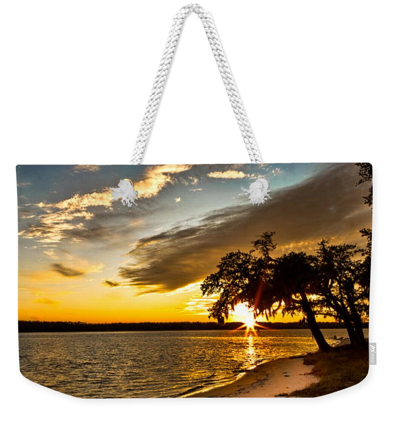 Sunset Weekender Tote Bag featuring the photograph Trapped Sunset by Christopher Holmes
