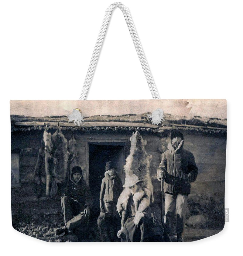 Old Photo Black And White Classic Saskatchewan Pioneers History Trappers Furs Amimals Weekender Tote Bag featuring the photograph Trappers by Andrea Lawrence