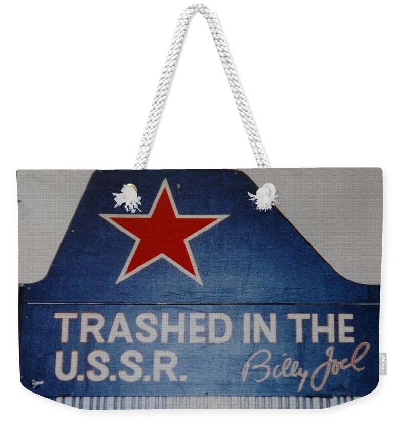 Billy Joel Weekender Tote Bag featuring the photograph Trashed In The U S S R by Rob Hans