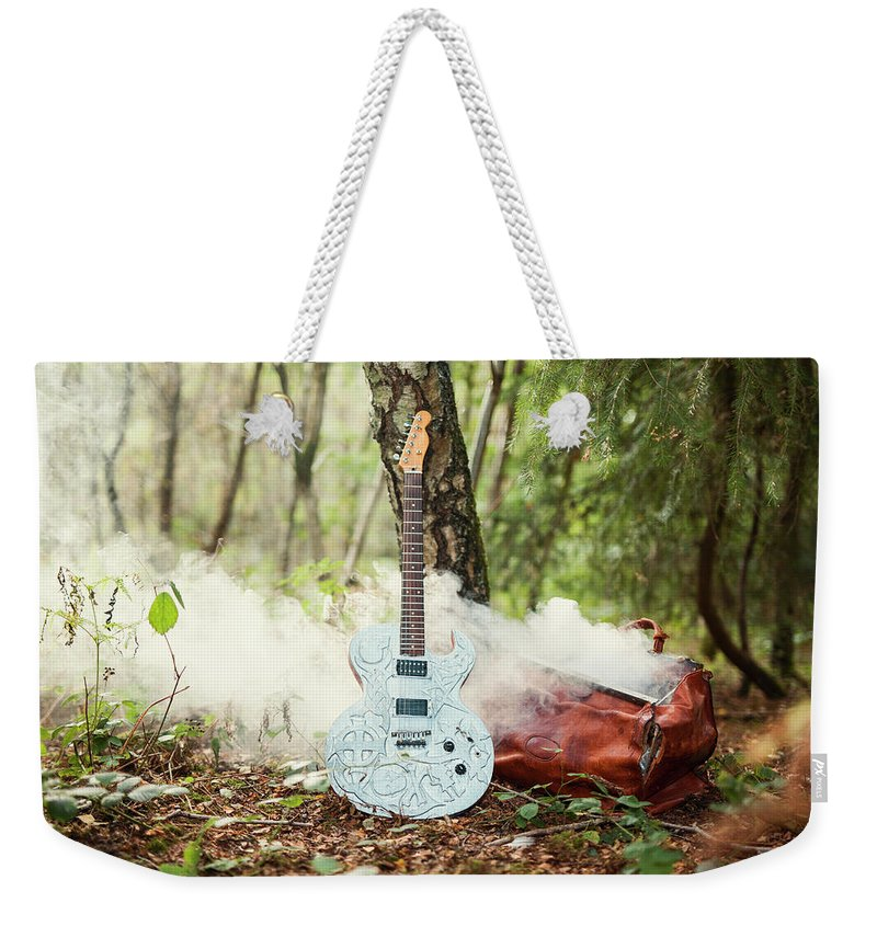 Guitar Weekender Tote Bag featuring the photograph Traveller's Bag by Rhii Photography