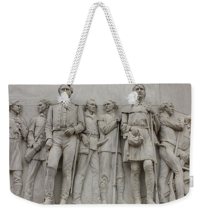 Alamo Weekender Tote Bag featuring the photograph Travis And Crockett On Alamo Monument by Carol Groenen