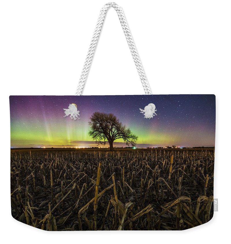 Aurora Weekender Tote Bag featuring the photograph Tree Of Wonder by Aaron J Groen