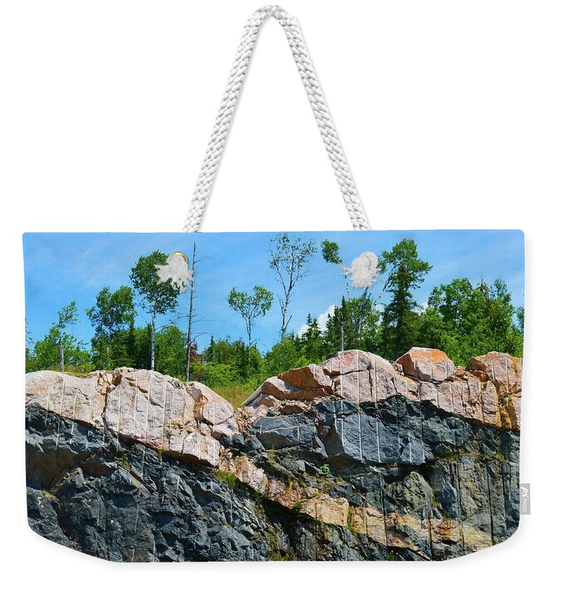 Abstract Weekender Tote Bag featuring the photograph Trees Above The Pink And Grey Rock by Lyle Crump