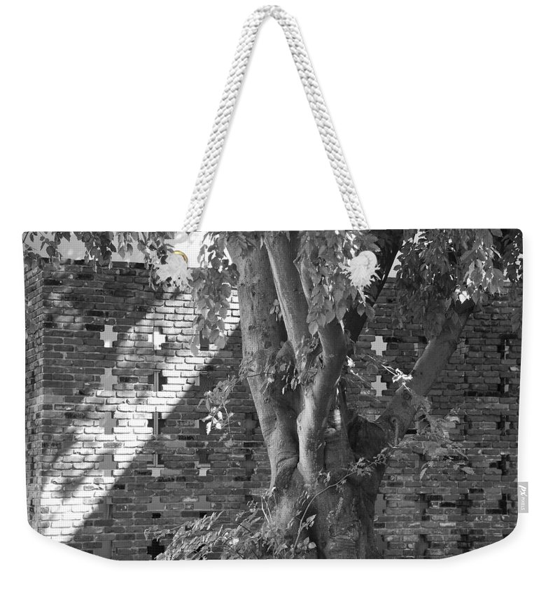 Trees Weekender Tote Bag featuring the photograph Trees And Brick Crosses by Rob Hans