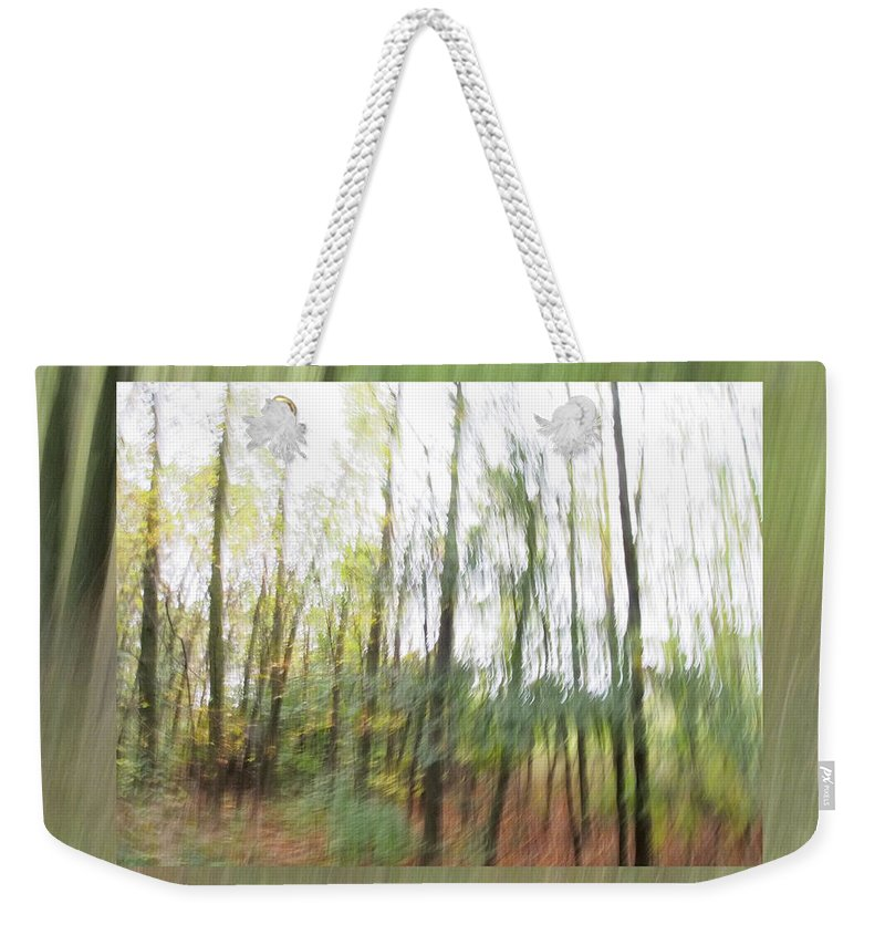 Leaf Weekender Tote Bag featuring the photograph Trees On The Move by Don Zawadiwsky