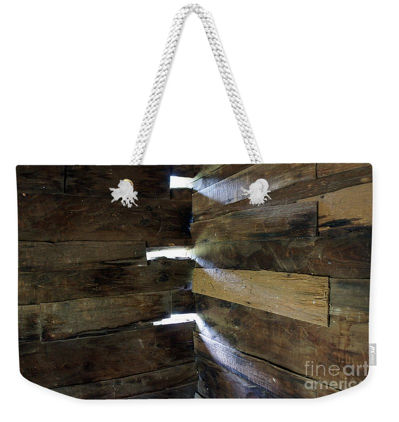 Wood Light Sun Beam ' Pattern Cabin Wall Corner Weekender Tote Bag featuring the photograph Trinity by Bob Bennett