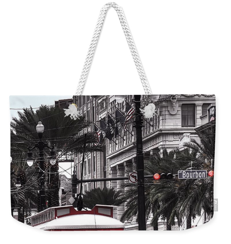 Nola Weekender Tote Bag featuring the photograph Trolley On Bourbon And Canal by Tammy Wetzel