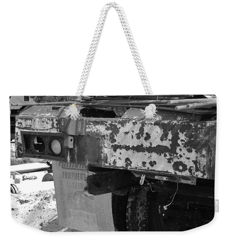 Black And White Weekender Tote Bag featuring the photograph Trucks And Sky by Rob Hans