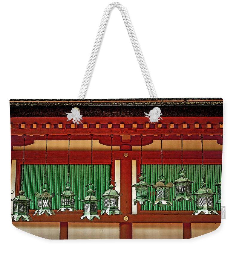 Japanesque Weekender Tote Bag featuring the photograph Tsuri-do-ro Or Hanging Lantern #0807-1 by Hiro Nishikawa