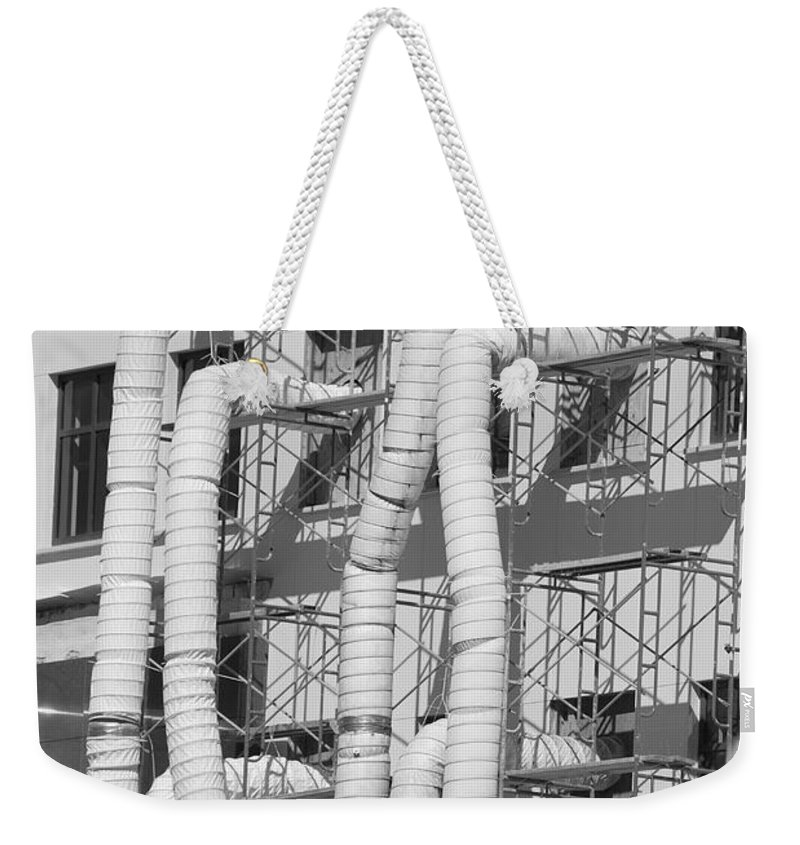 Tubes Weekender Tote Bag featuring the photograph Tube Construction by Rob Hans
