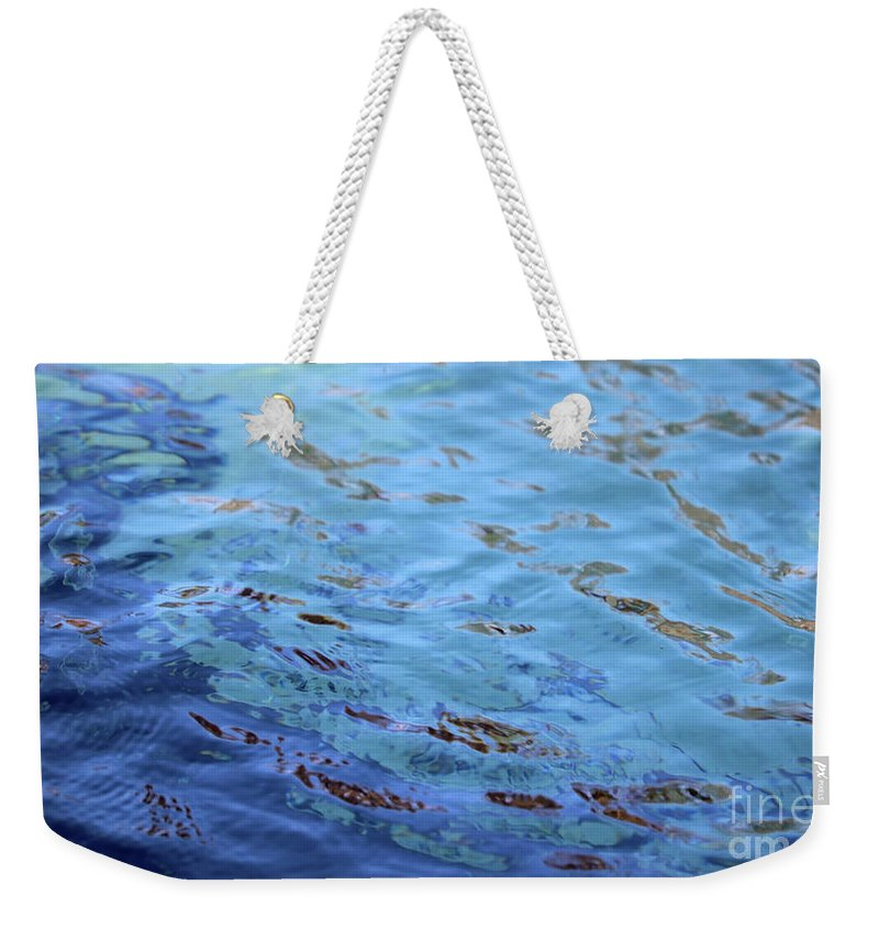 Water Weekender Tote Bag featuring the photograph Turquoise And Blue Swirls Large Canvas by Carol Groenen