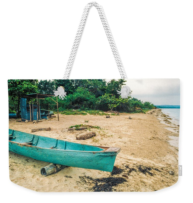 Canoe Weekender Tote Bag featuring the photograph Turquoise Canoe Negril by David Stone